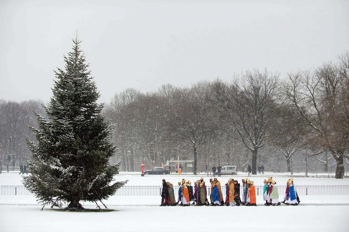 Carol singers from the Paderborn Archdiocese walking through the snow covered grounds of Schloss Bellevue in Berlin, Germany, on Jan 6, 2016.