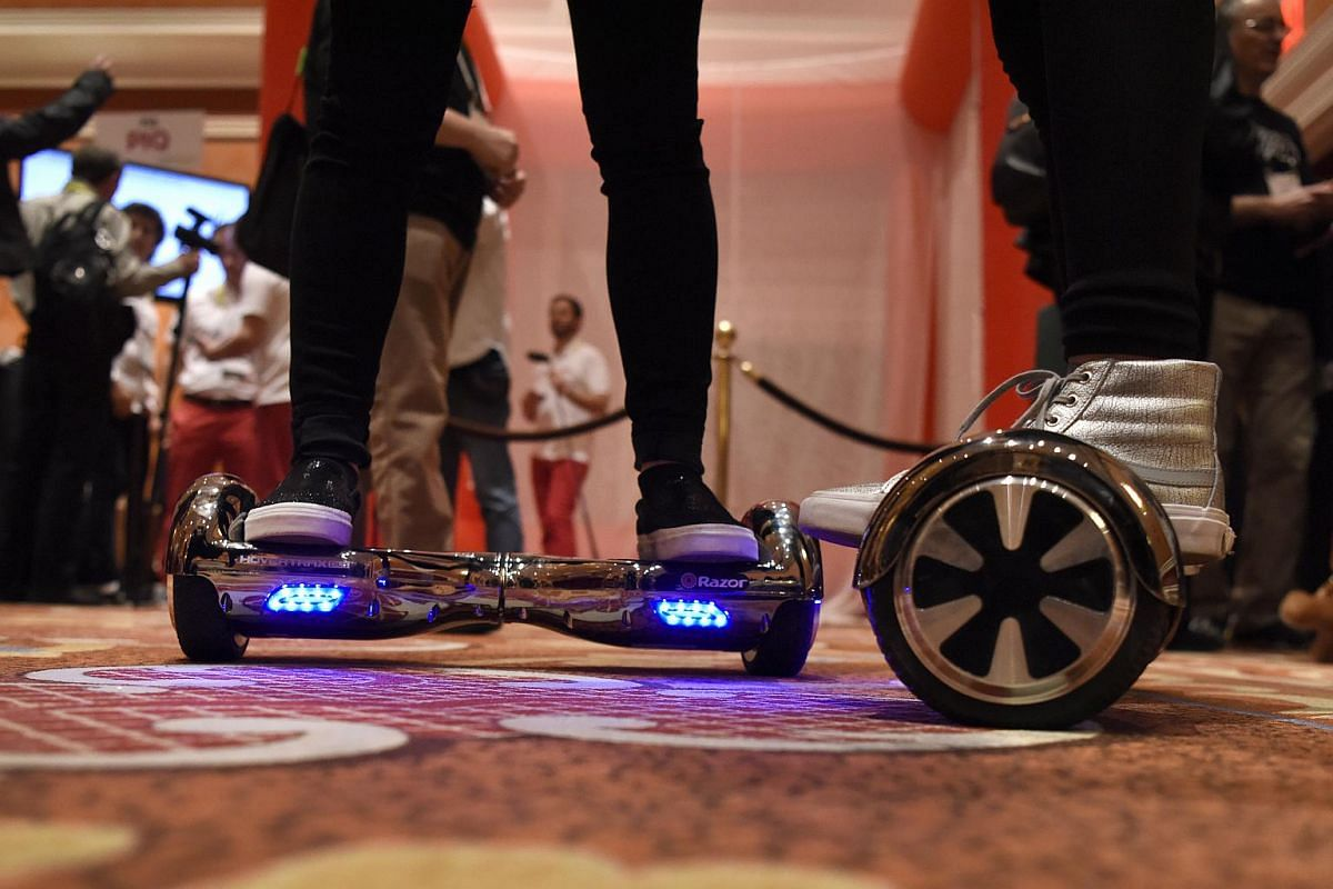 Exhibitors riding Razor Hovertrax Hover Boards during ShowStoppers at CES 2016.