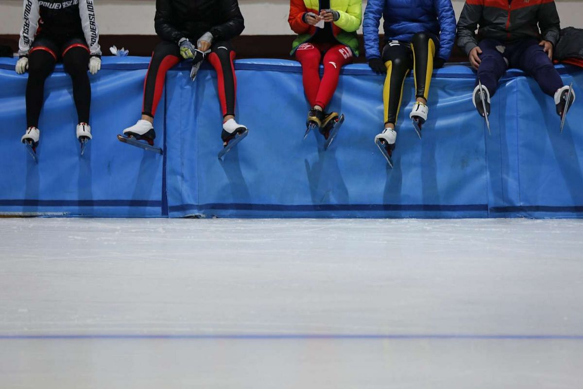 Chinese students resting during a speed skating training session at Harbin ice and snow sports school on Jan 7, 2016.