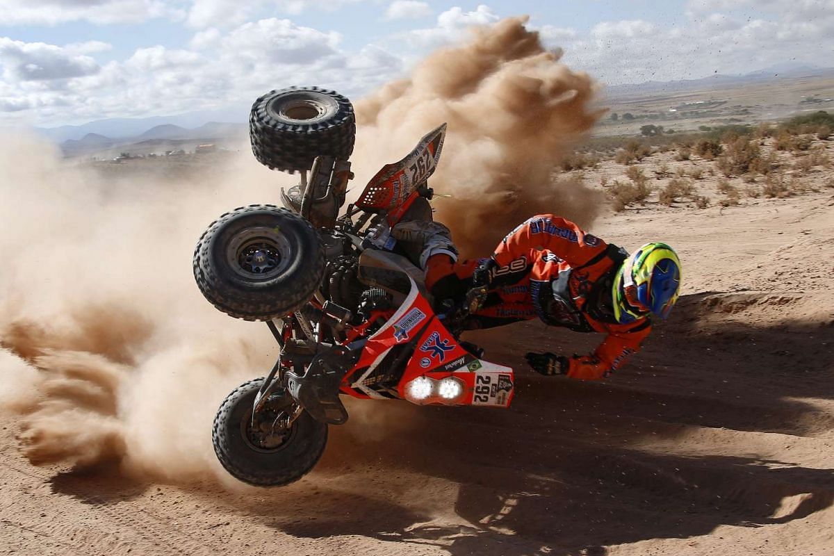 Brazilian Marcelo Medeiros of Yamaha team taking a tumble during the fifth stage of the Rally Dakar 2016 on Jan 7, 2016.