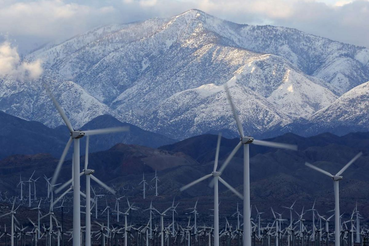 Snow seen on the San Gorgonio Mountains behind a windmill farm in Palm Springs, California, on Jan 7, 2016.