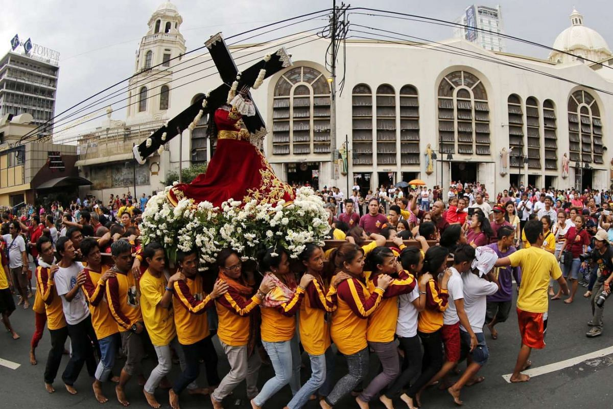 Barefoot Catholics carrying a replica of the Black Nazarene during a procession ahead of the Black Nazarene feast day celebrations in Manila, Philippines, on Jan 7, 2016.