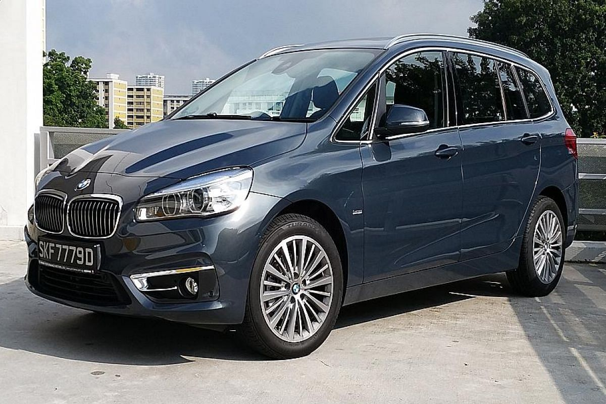 The BMW 216d Gran Tourer comes with flip-down, height- adjustable picnic tables in the second row (left).