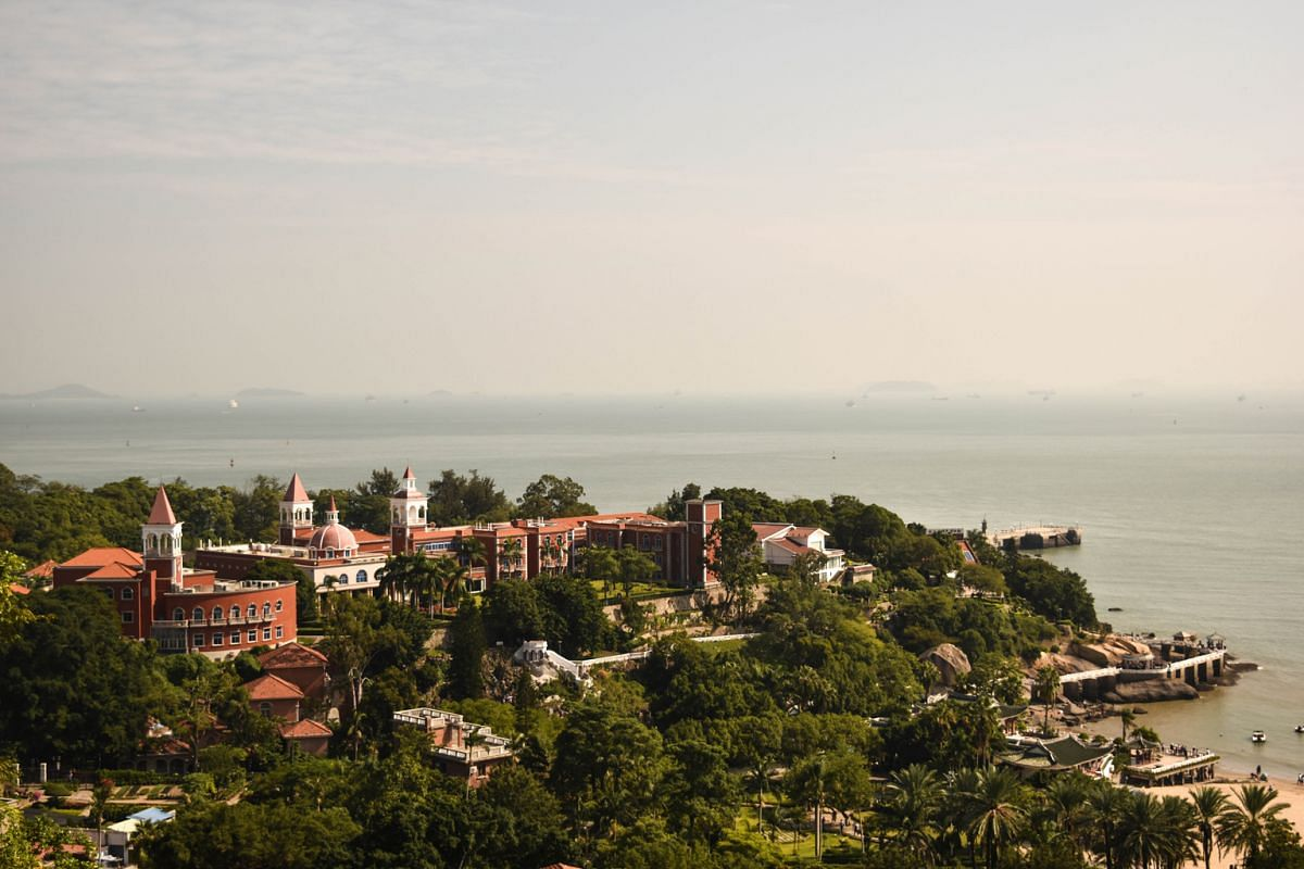 Many visitors are drawn to the shady boulevards and beautifully manicured gardens of Shamian Island and Gulangyu (above).