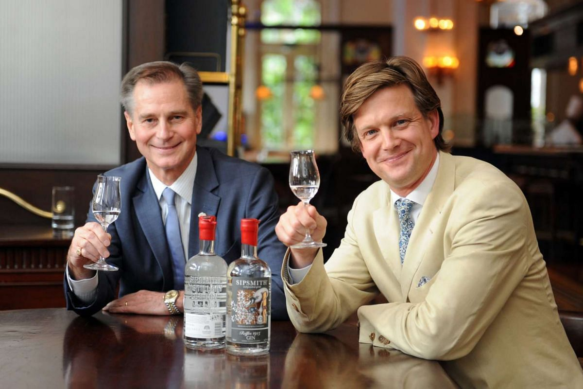 Mr Simon Hirst (left), general manager of Raffles Singapore, and Mr Sam Galsworthy toasting with the customised Raffles 1915 Gin.