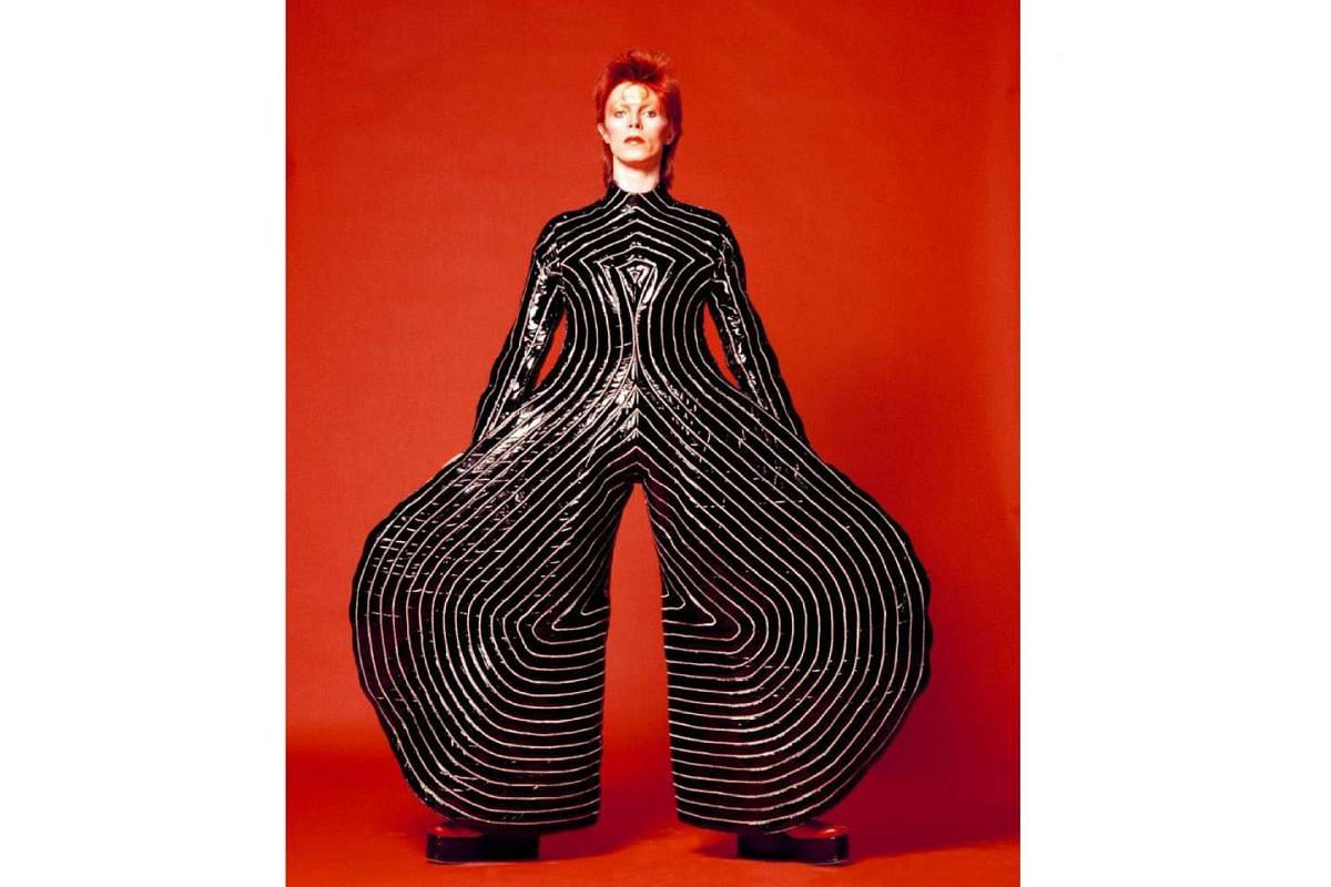 The singer in a striking outfit designed by Kansai Yamamoto for his 1973 Aladdin Sane tour.