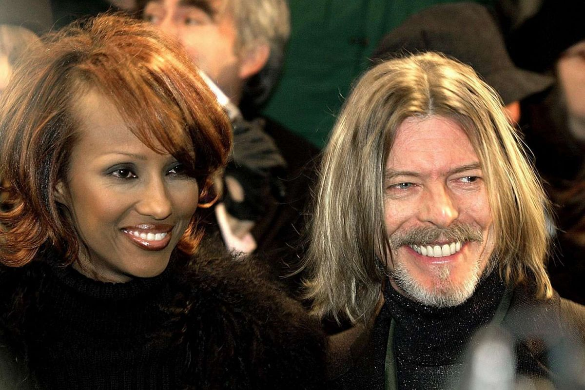 The singer with his wife, supermodel Iman, whom he married in 1992, at the New York premiere of the movie Hannibal in 2001.