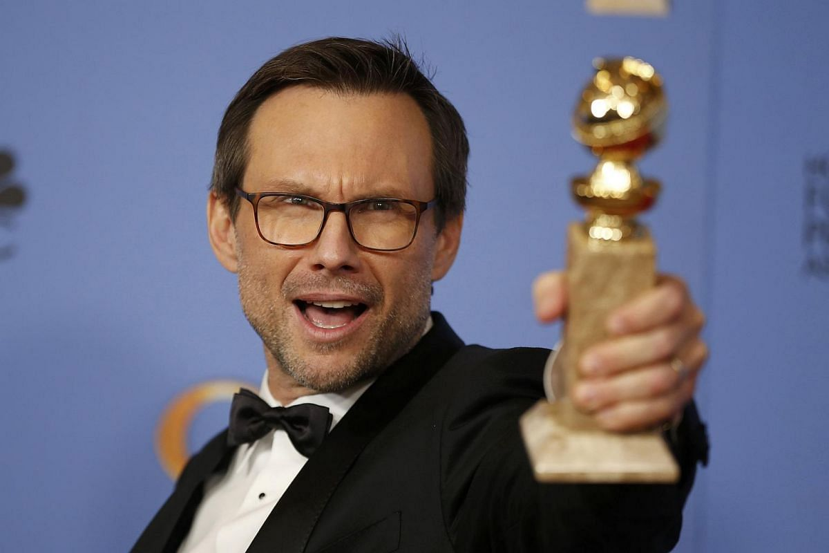 Christian Slater poses backstage with the award for Best Performance by an Actor in a Supporting Role in a Series, Limited Series or Motion Picture Made for Television for his role in Mr. Robot at the 73rd Golden Globe Awards in Beverly Hills, Califo