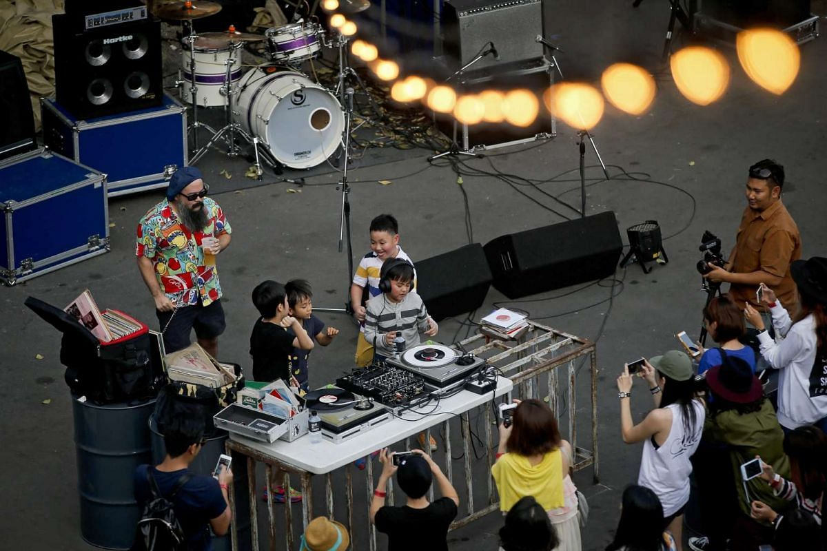 Japanese children pretending to be DJs at the vintage market Made By Legacy in Bangkok, Thailand, on Jan 10, 2016.