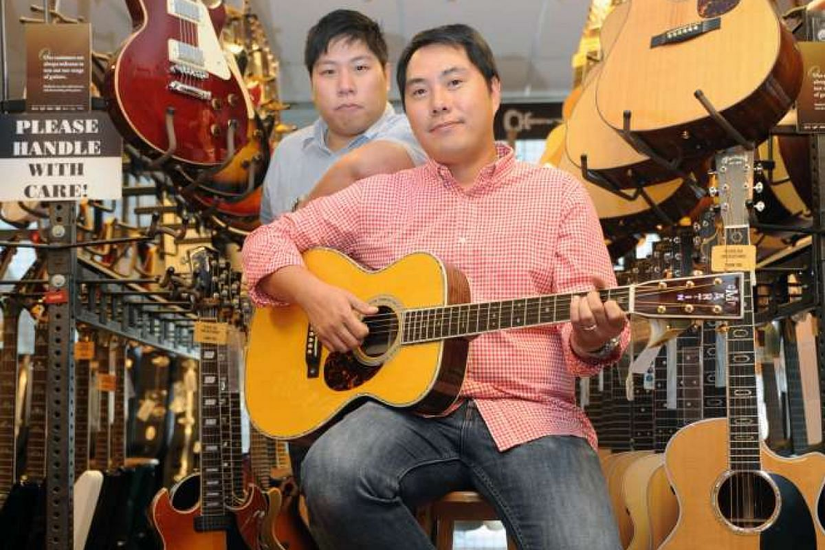 Hoe brothers Yeegn Lougn (seated) and Hsin Loong have kept City Music up to date by setting up an online store and computerising its point-of-sale systems.