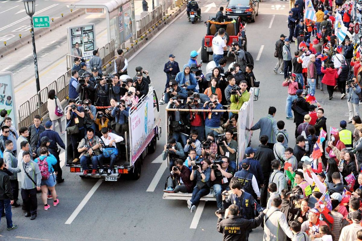 Journalists jamming trucks to catch images of Mr Eric Chu (not pictured), a presidential candidate from the ruling Kuomintang (KMT), during an election campaign in Taipei on Jan 9, 2016.