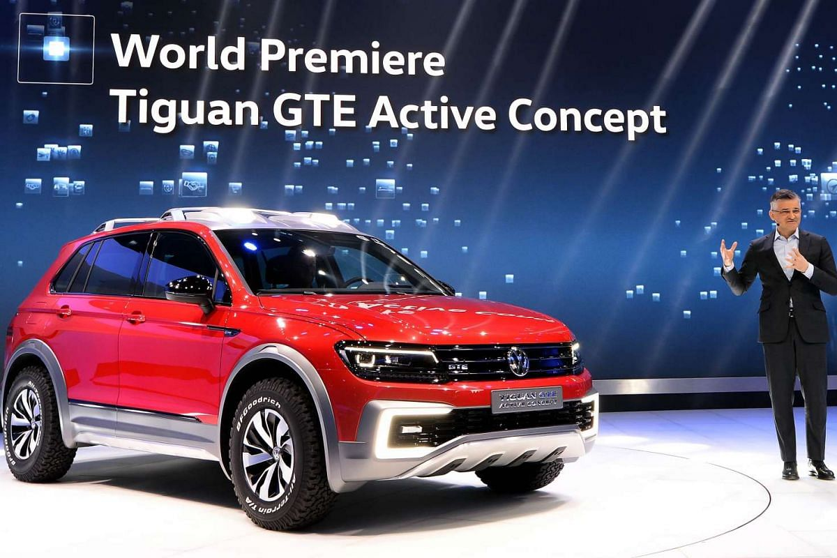 President and CEO Michael Horn of the Volkswagen group of America presents the Tiguan GTE Active Concept SUV at the North American International Auto Show in Detroit, Michigan, on Jan 11, 2016.