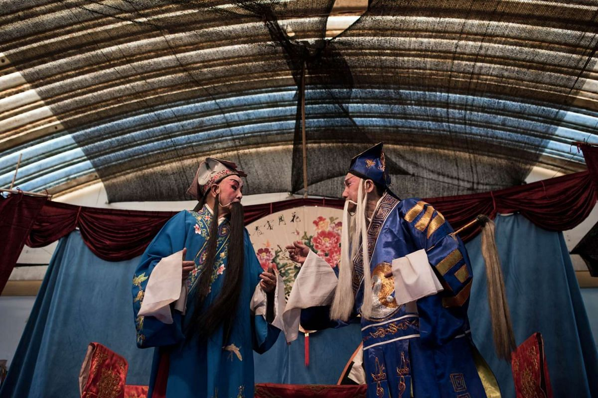 Chinese actors performing during a show in Kunming on Jan 7, 2016.