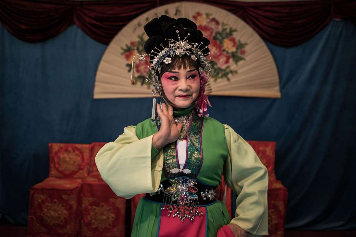 Zhong Huifangi of the 'Flower Lantern' troupe posing for a picture after a show.