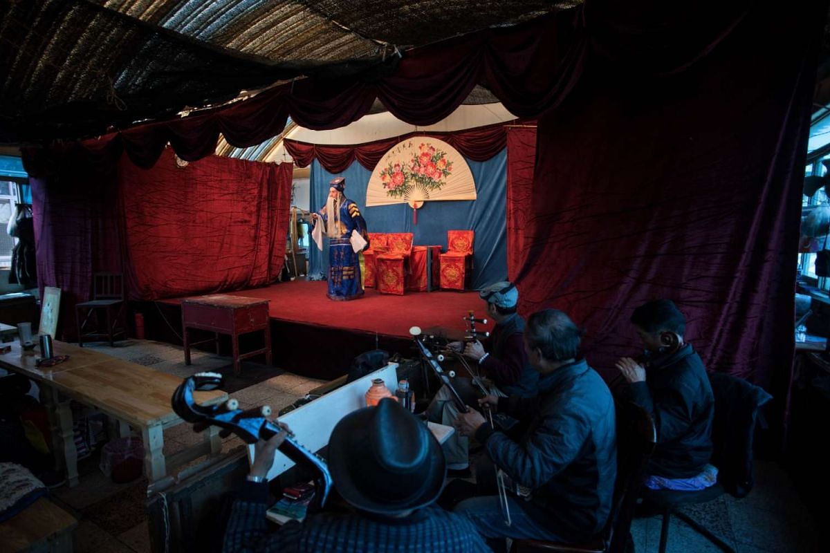 Musicians playing during a performance in Kunming on Jan 7, 2016.