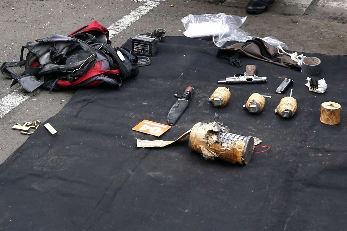 11.20am: The arsenal of weapons that the attackers were carrying after the bomb blast on Jan 14, 2016.