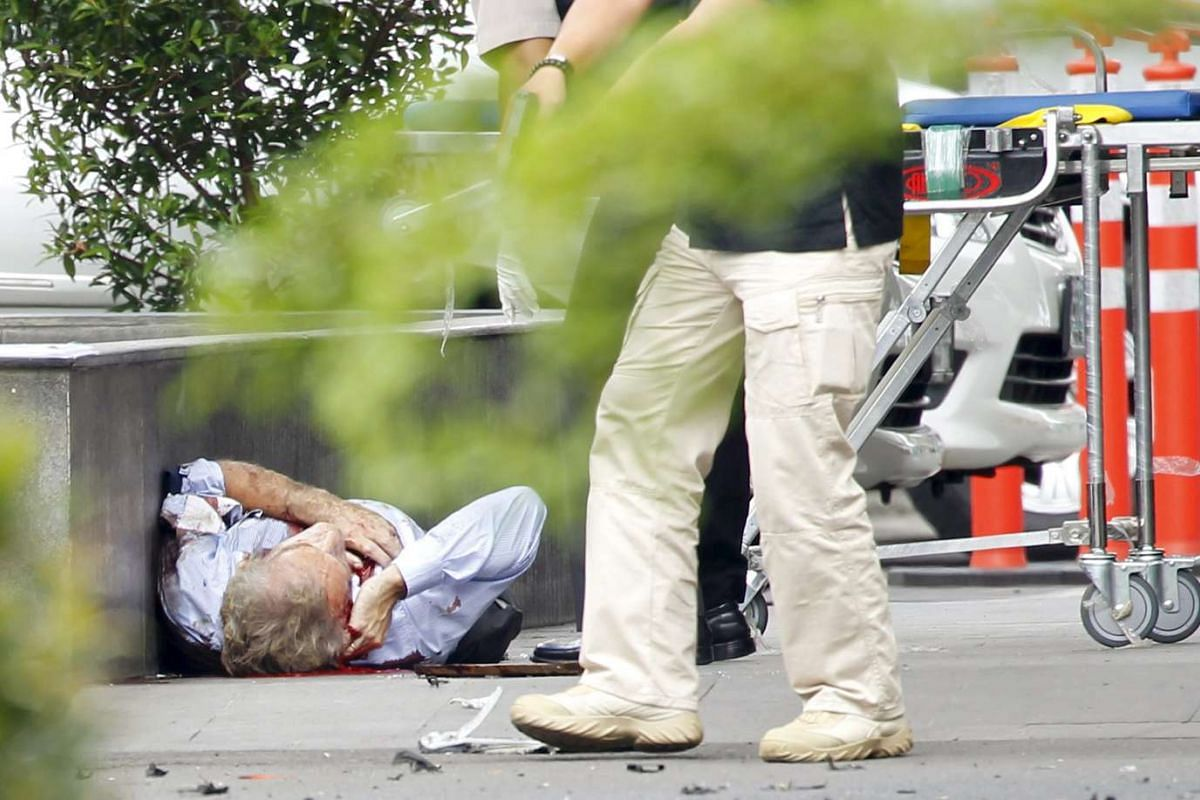 11am: A wounded foreign national lies surrounded by security and emergency workers following the attack in Jakarta on Jan 14, 2016.
