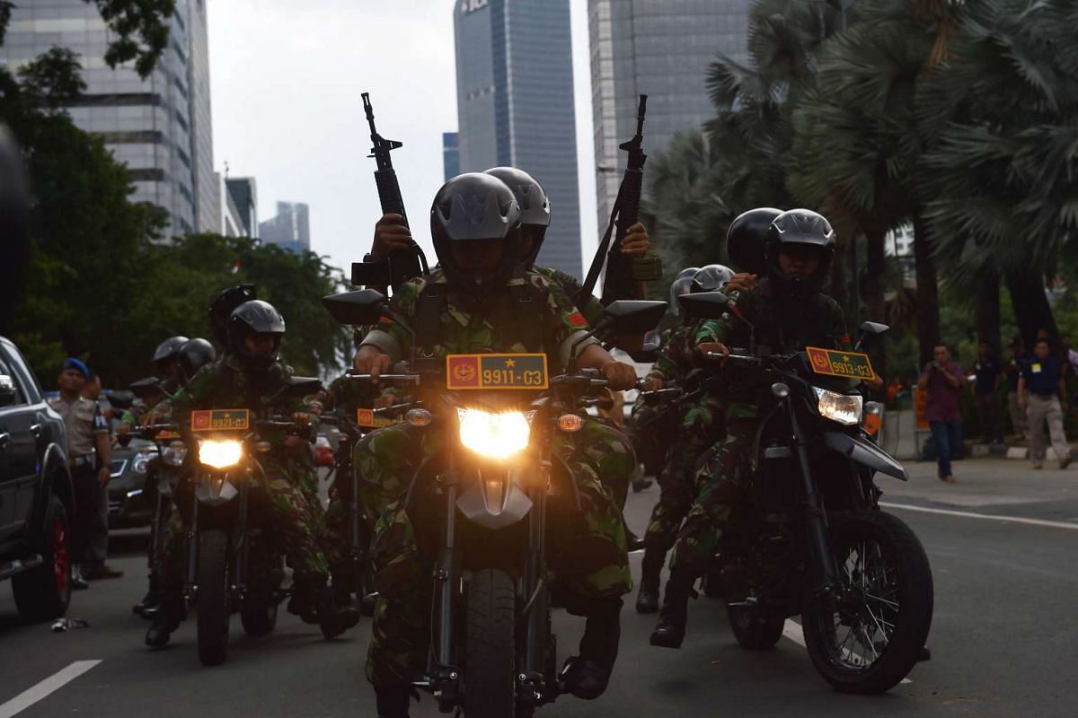 11.20am: Indonesian armed military personnel patrolling the area near a cafe after a series of blasts hit Jakarta on Jan 14, 2016.
