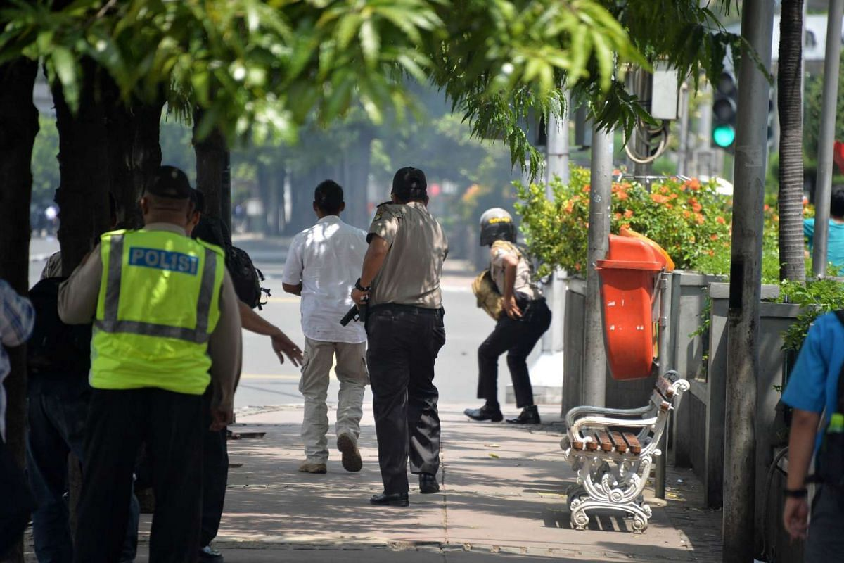 10.50 - 10.55am: Police chase suspects thought to be hiding at the cafe after a series of blasts hit the Indonesia capital Jakarta on Jan 14, 2016.