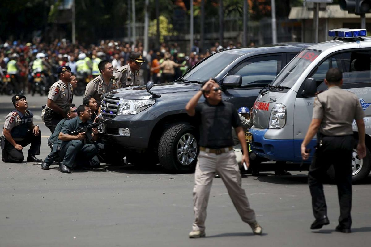 10.50 - 10.55am: Police officers near the site of a blast in Jakarta on Jan 14, 2016.