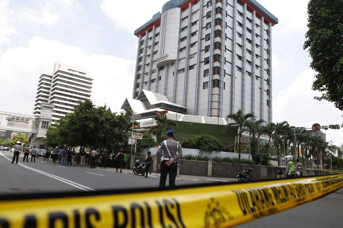 11.20am: A police cordon sealing off the scene of a bomb blast in Jakarta on Jan 14, 2016.