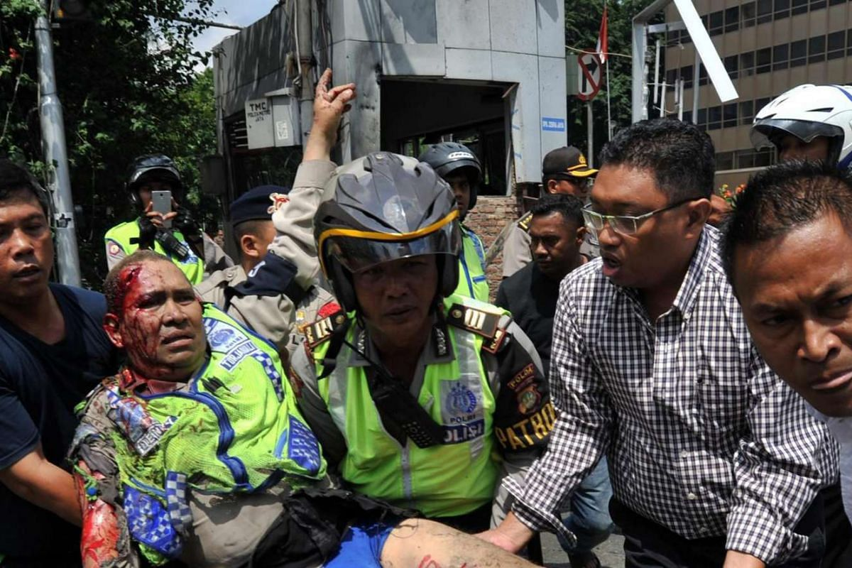 11am: An injured Indonesian policeman is evacuated from the site of a bomb blast in Jakarta on Jan 14, 2016.