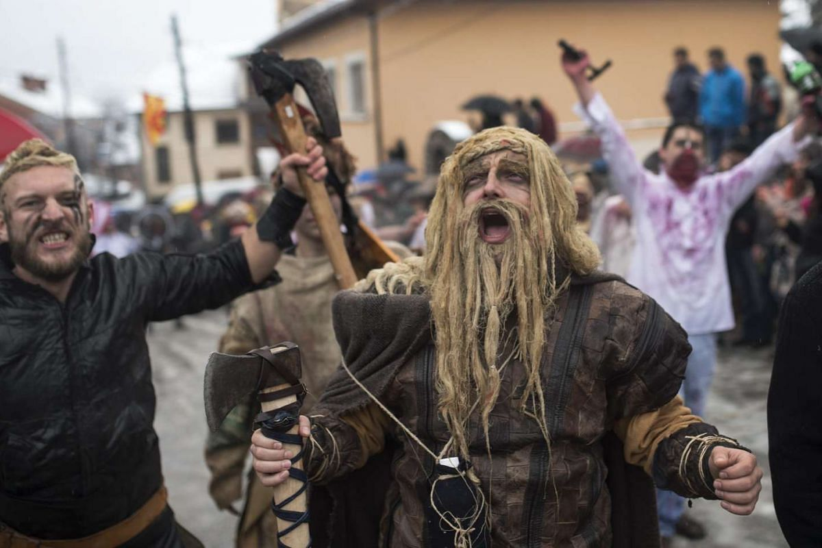Local villagers wearing homemade costumes parade during a carnival celebration marking the Orthodox St Vasilij Day in the village of Vevcani, the former Yugoslav Republic of Macedonia, on Jan 13, 2016.