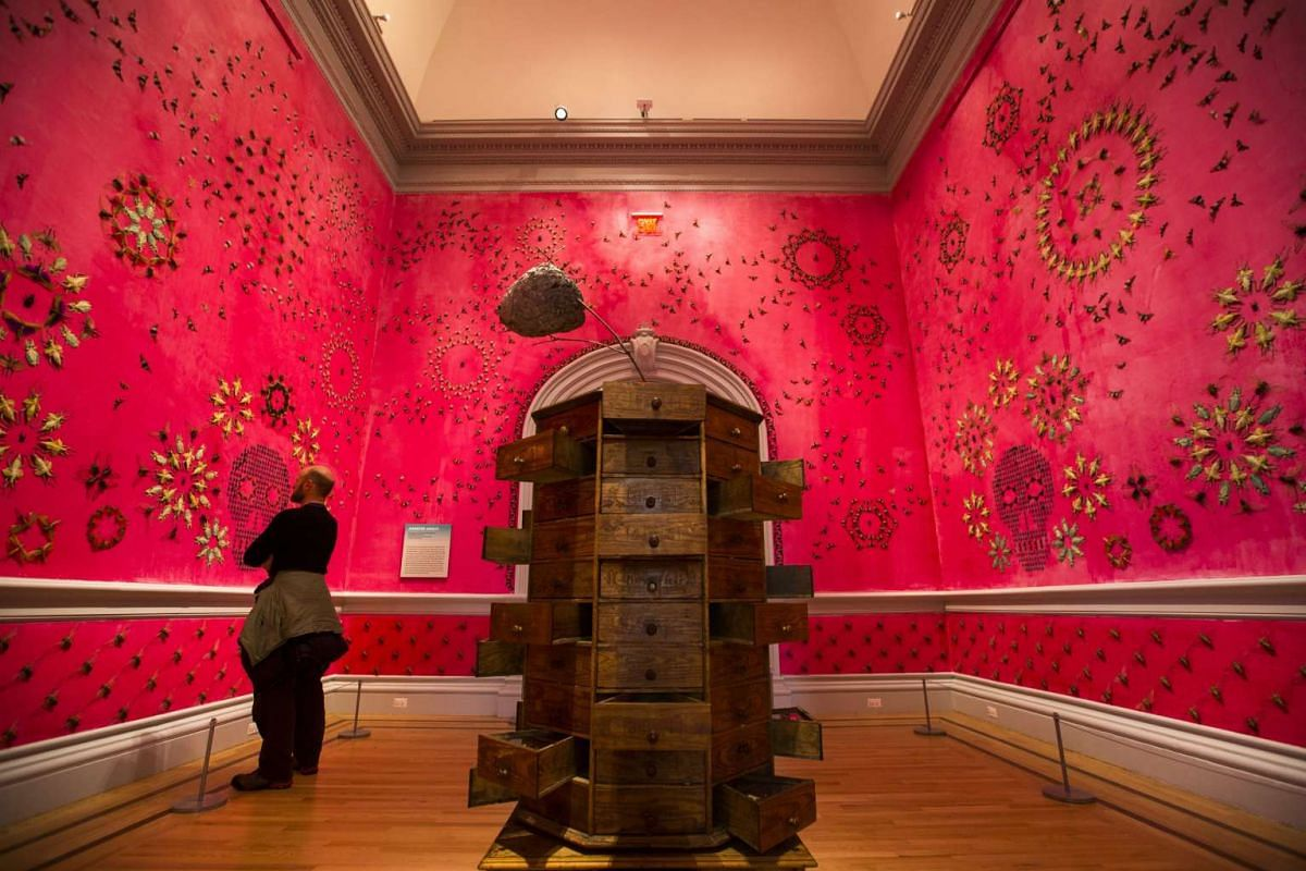 A visitor takes in a piece called In the Midnight Garden by artist Jennifer Angus, at the Wonder exhibit displayed at the Renwick Art Gallery in Washington, DC.