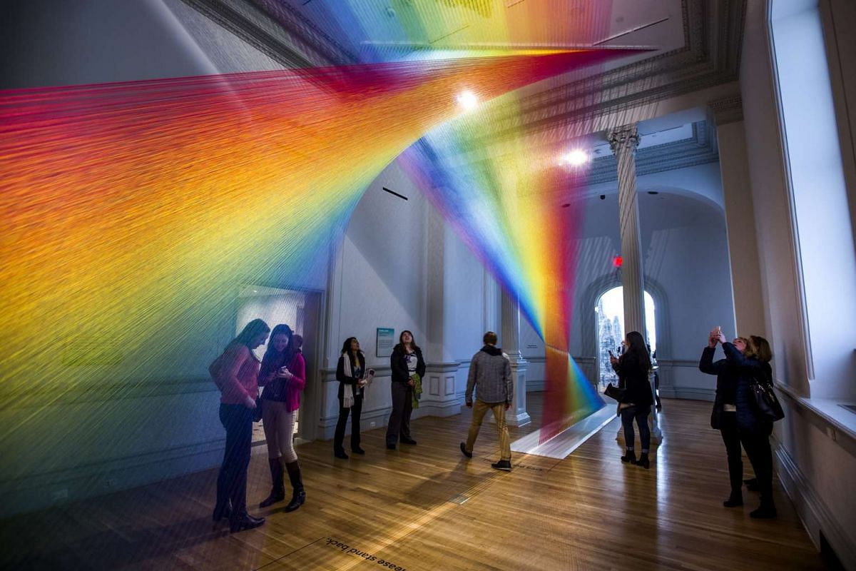 Visitors take in an installation called Plexus A1 by artist Gabriel Dawe, at the Wonder exhibit displayed at the Renwick Art Gallery in Washington, DC.
