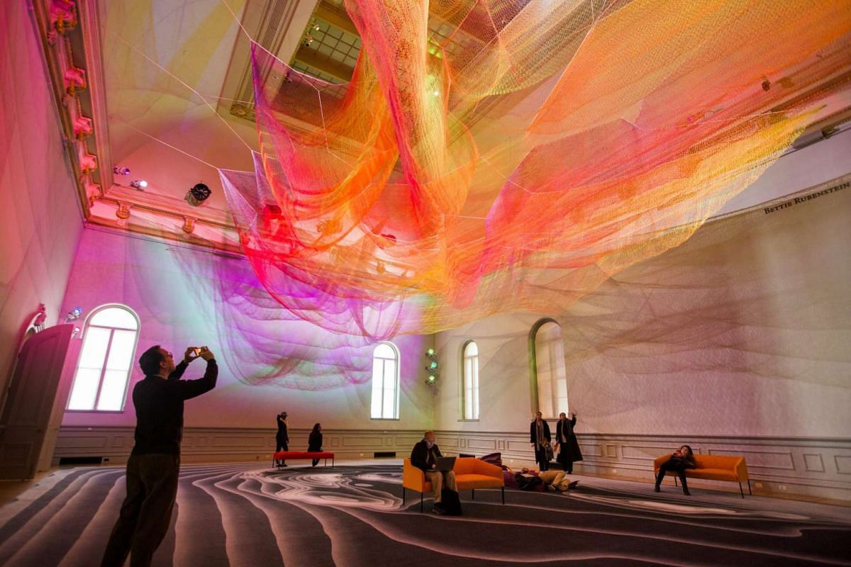 Visitors take in a piece called 1.8 by artist Janet Echelman, at the Wonder exhibit displayed at the Renwick Art Gallery in Washington, DC.