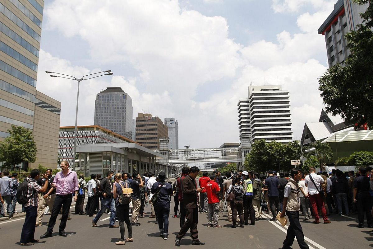 People gathering at the scene of the bomb blast in Jakarta.
