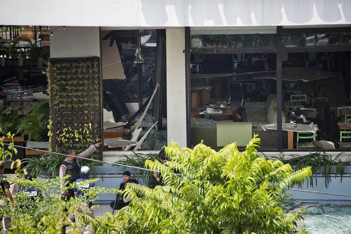 10.50 - 10.55am: Indonesian police securing the area in front of the damaged Starbucks cafe.