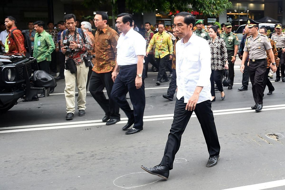 Indonesian President Joko Widodo (right, foreground) inspecting the area outside the Starbucks cafe on Jan 14, 2016.