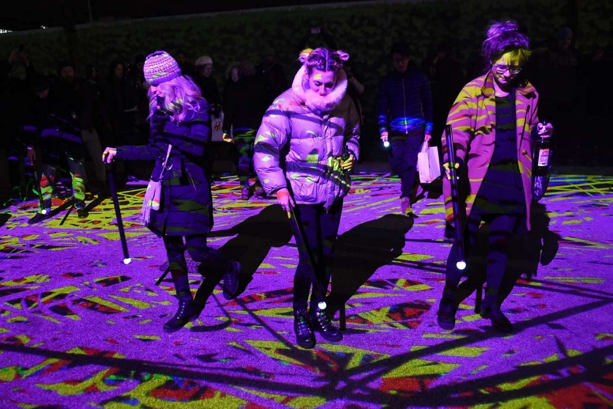 Visitors taking part in a light installation during the Lumiere festival in London, Britain, on Jan 14, 2016.