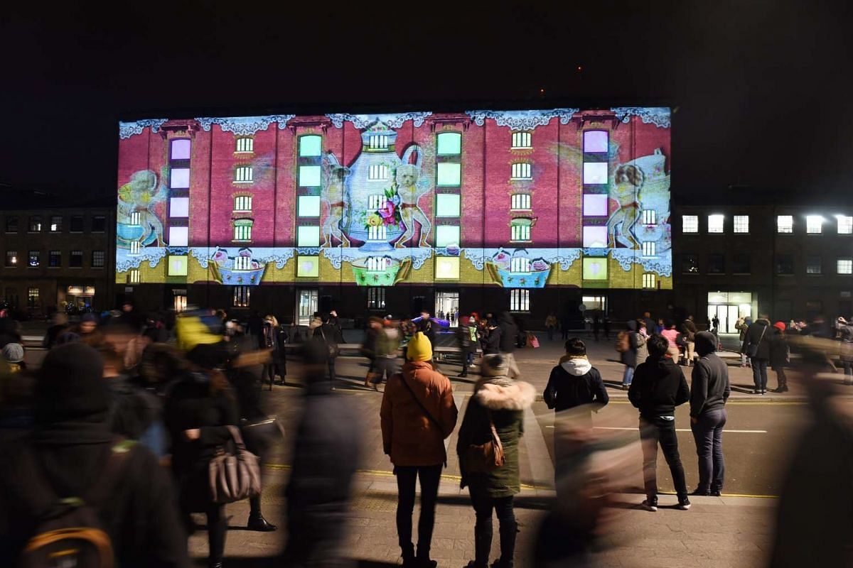 Visitors looking at a light installation during the Lumiere festival in London, Britain, on Jan 14, 2016.