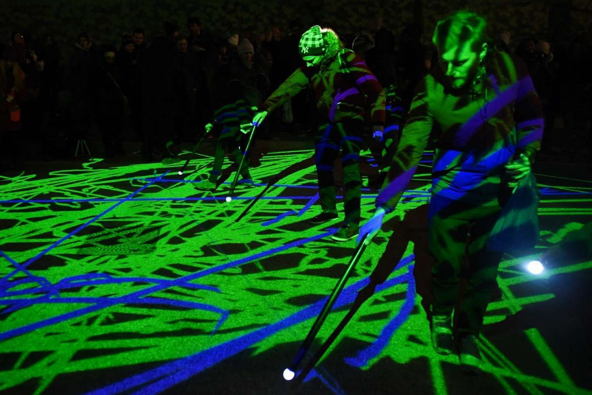 Visitors taking part in a light installation during the Lumiere festival in London.