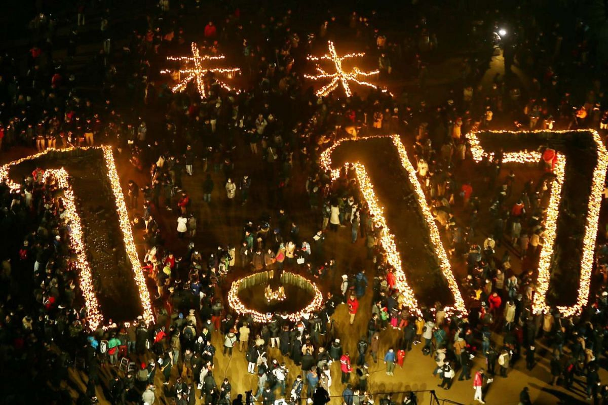 """Candles indicating """"Future 1.17"""" during a memorial service to mark the 21st anniversary of the Great Hanshin Earthquake at a park in Kobe, Japan on Jan 17, 2016. More than 6,400 people were killed in the 1995 quake."""