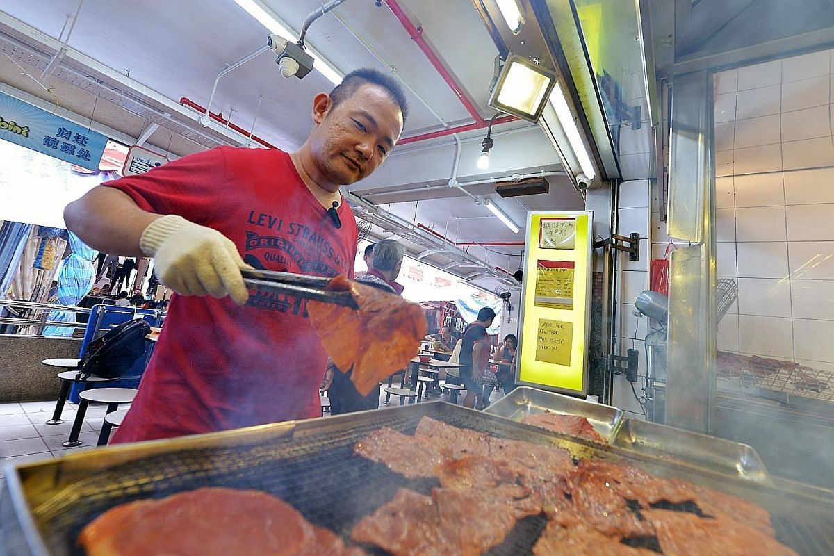 Administrative executive Zhang Ziyue (left) quit his job three years ago to start Peng Guan at Chinatown Complex Market & Food Centre. Mr Ng Thiam Heng is a second-generation owner of Kim Hua Guan at People's Park Food Centre.