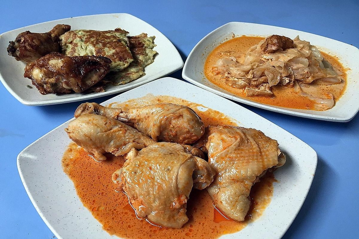 Babas Peranakan's (clockwise from top left) ayam goreng, onion omelette, sayur lemak and satay ayam curry.