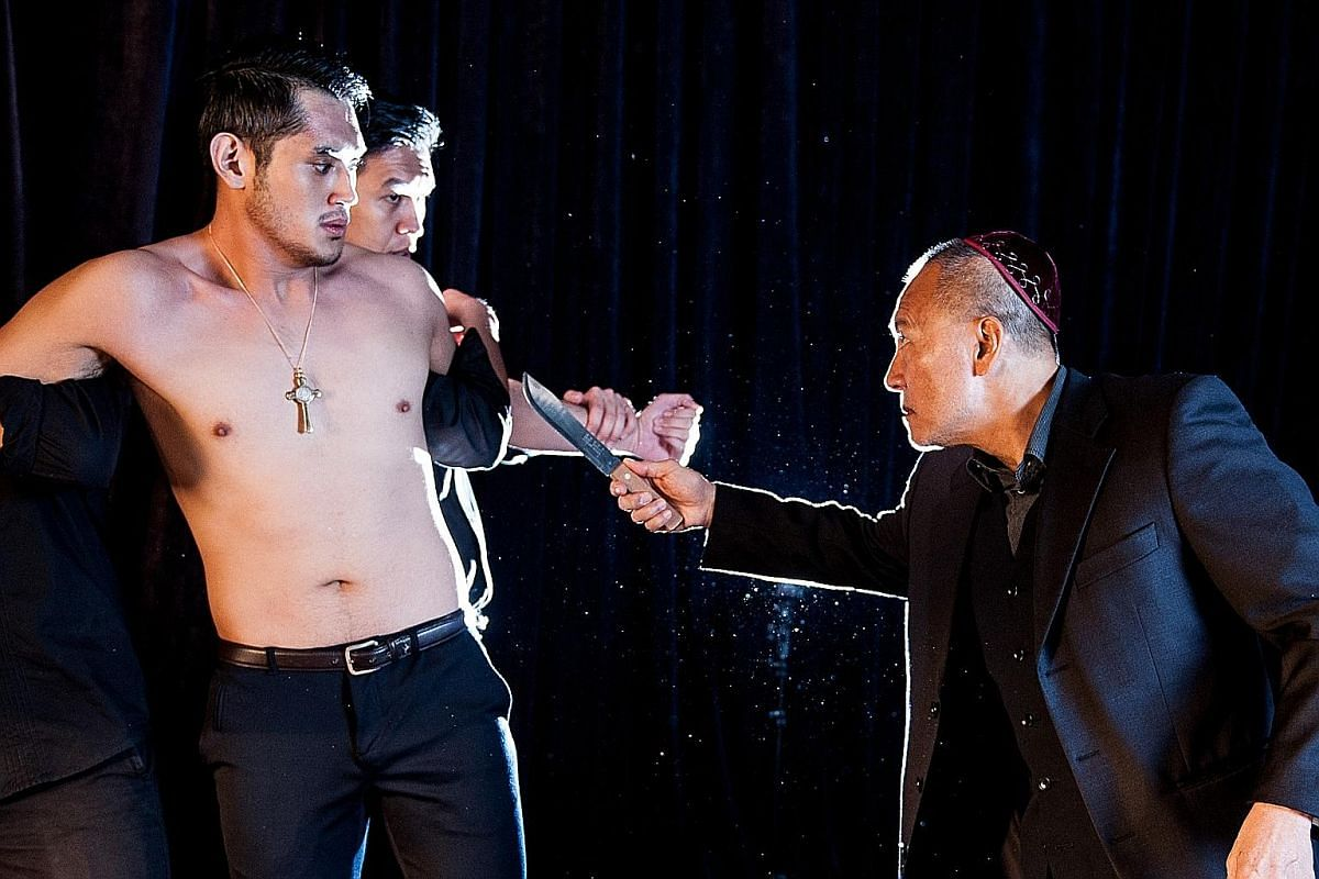 Shylock (reprised by Lim Soon Heng, above right) preparing to cut off the flesh from Antonio (Ivan Chan) in the KL Shakespeare Players' The Merchant Of Venice.