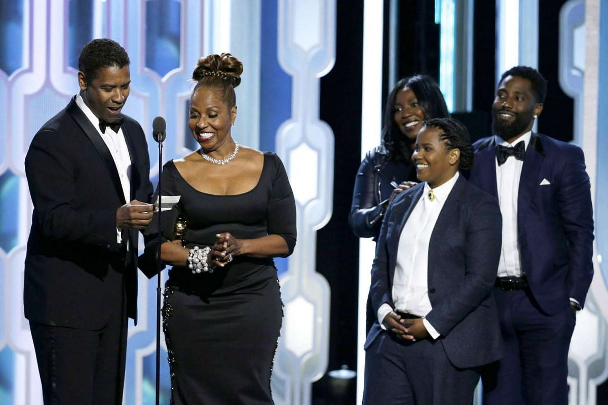 Actor Denzel Washington (above, from left) with his wife Pauletta Washington, daughters Olivia and Katia and son John David.