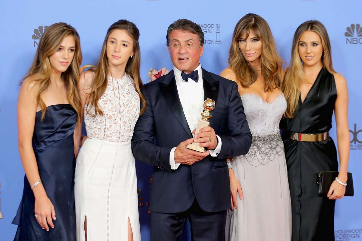 Actor Sylvester Stallone poses with his wife Jennifer Flavin (above, second from right) and daughters (from left) Sistine, Sophia and Scarlet.