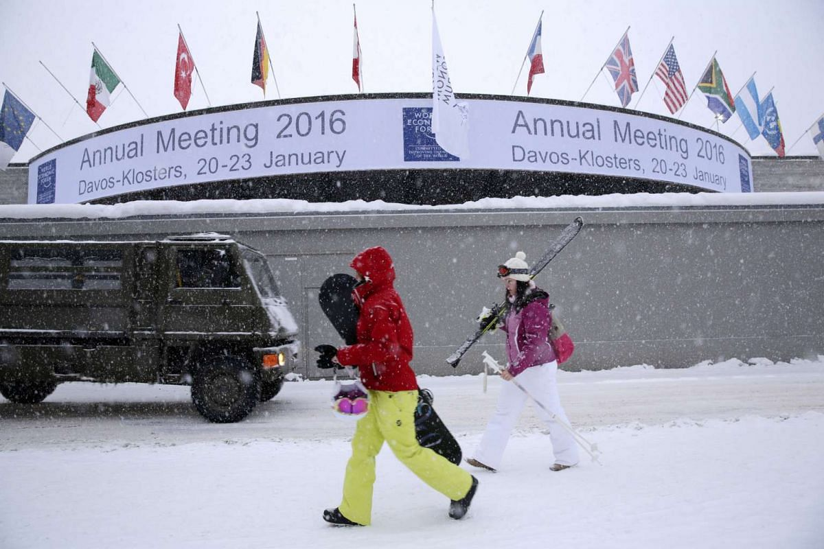 Winter sports enthusiasts and an army truck pass the Congress conference centre in Davos, Switzerland, on Jan. 16, 2016. Preparations are underway in full swing as Davos prepares for yet another summit. More than 2,500 participants, including close t