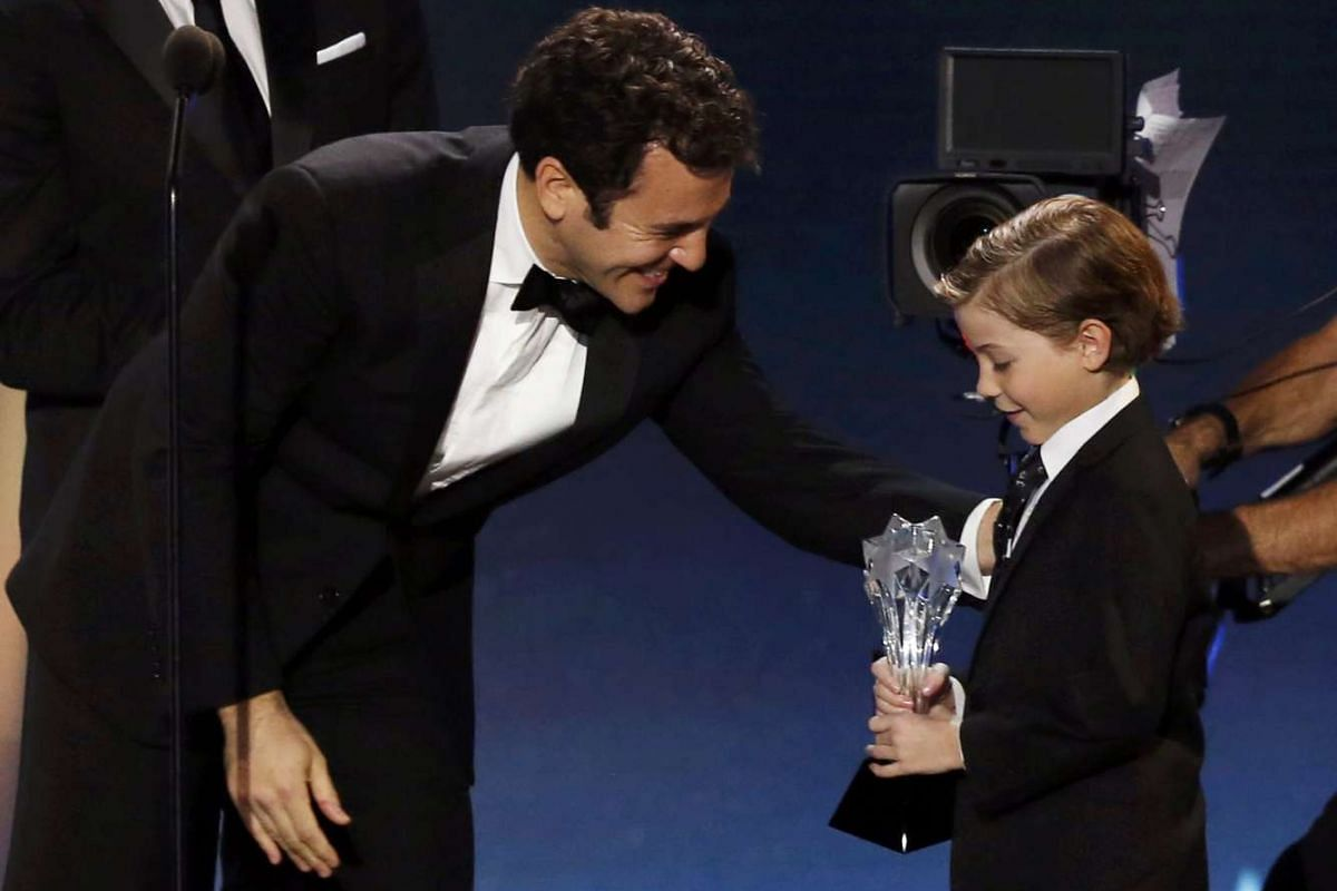 From one ex-child star to a new child star: Fred Savage (left) presents Best Young Actor award to Jacob Tremblay.