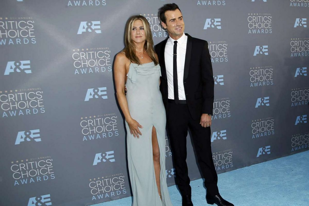 Sometimes, the best accessory is arm candy. Jennifer Aniston arrives with Justin Theroux.