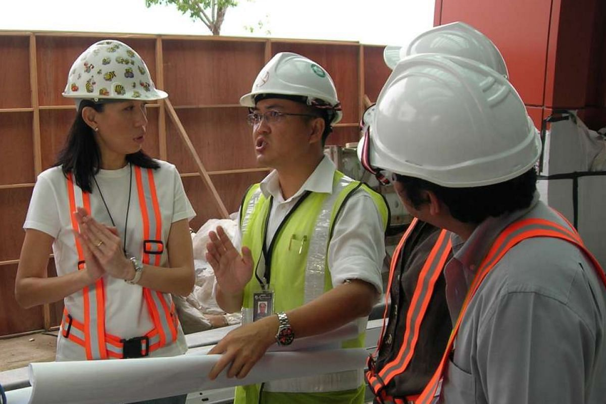 My life so far: Ms Chan with her colleagues on the Suntec City project in 1992; and on site at Resorts World Sentosa in 2010 (above), where she wore a hard hat she customised with stickers of busy worker bees