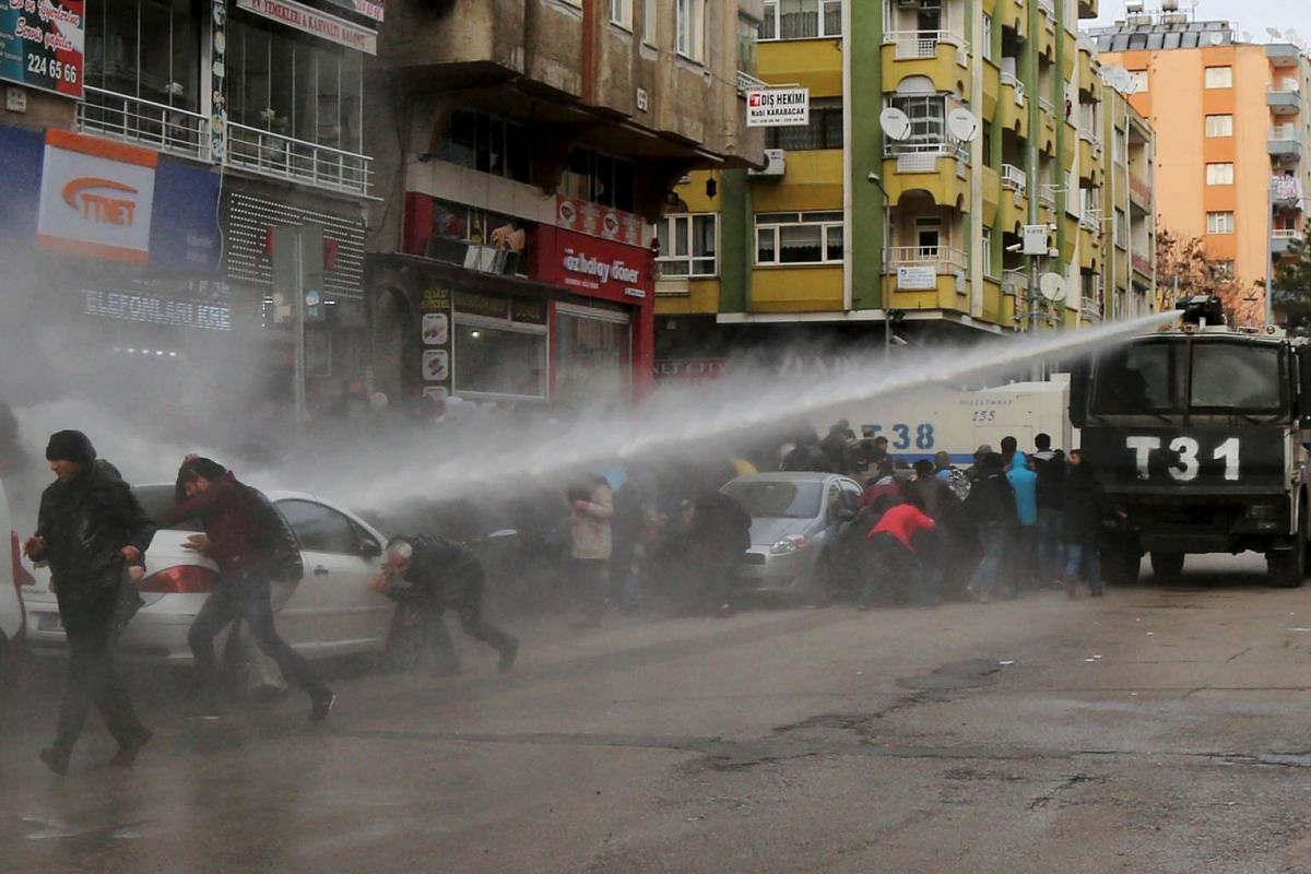 Turkish riot police disperse Kurdish demonstrators with a water cannon during a protest against a curfew in Sur district and security operations on Jan 17, 2016.