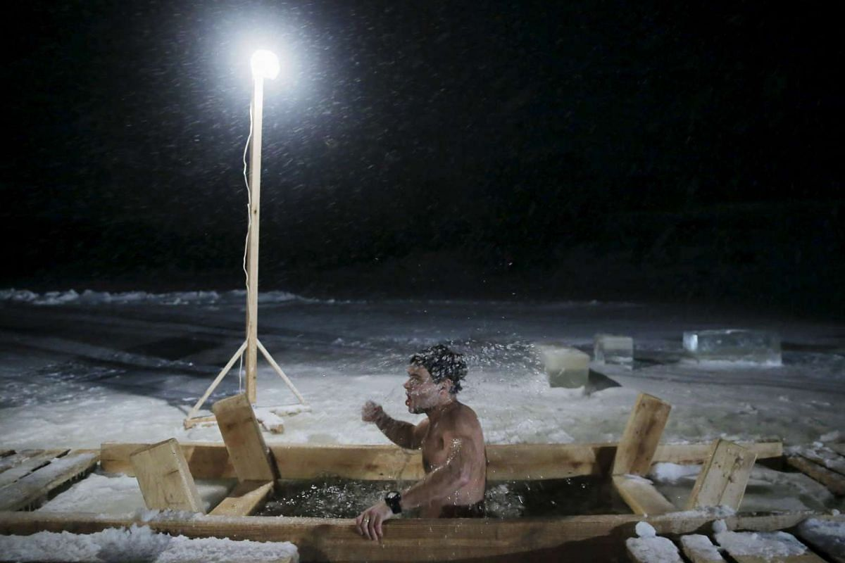 A man immerses himself in icy waters during the Orthodox Epiphany holiday on Jan 18, 2016.