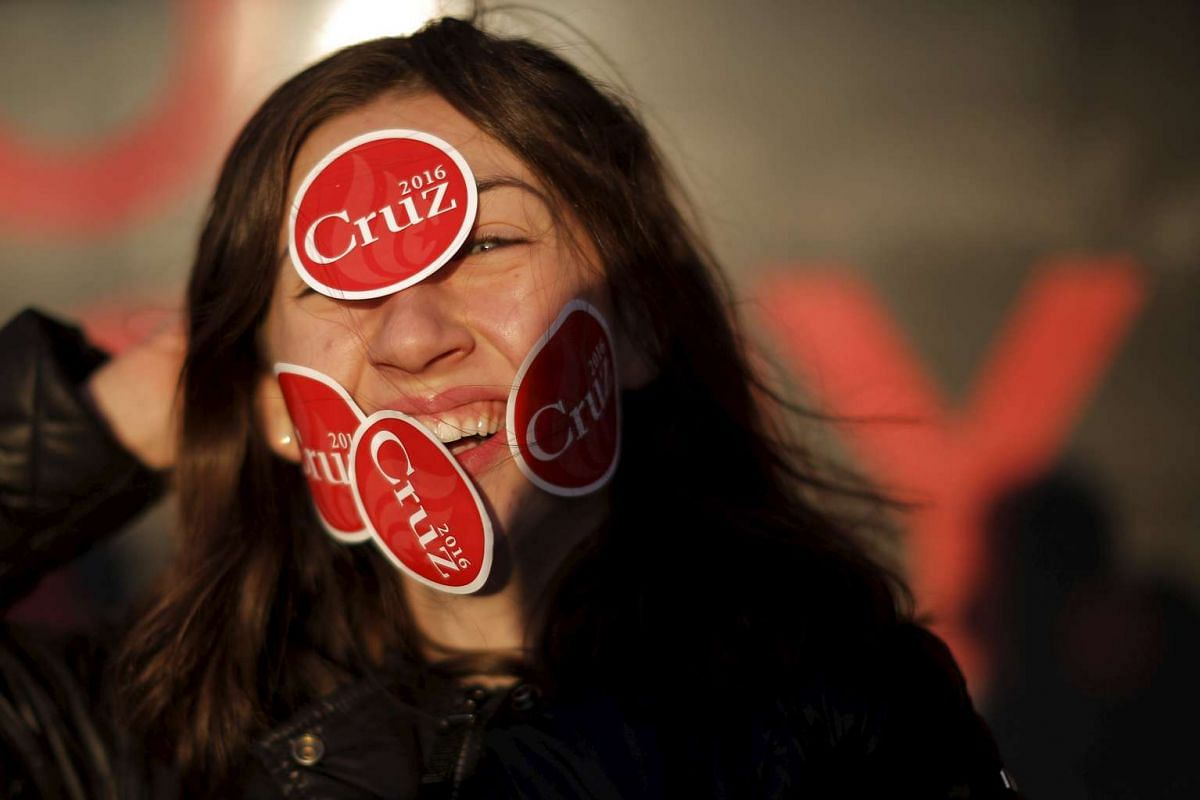 Delaney Anne poses for photographs with stickers on her face following a campaign stop by United States Republican presidential candidate and  United States Senator Ted Cruz at the Tilt'n Diner in Tilton, New Hampshire, on Jan 18, 2016. PHOTO: REUTER