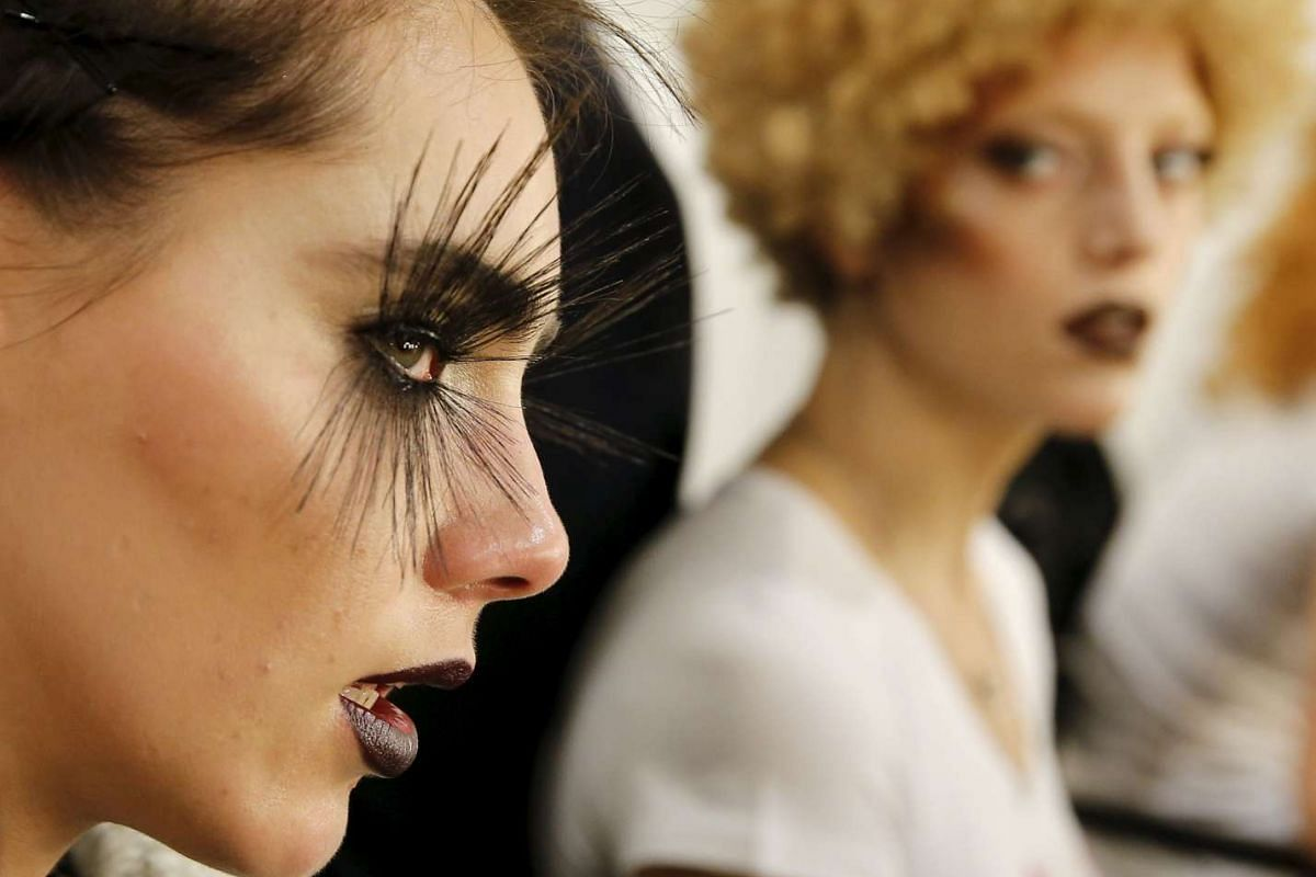 Models prepare backstage before a show by Maybelline New York on Jan 18, 2016.